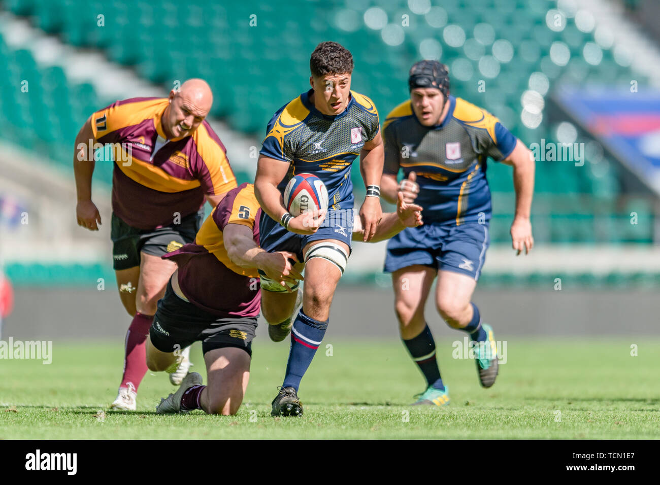 London, UK. 08th, Jun 2019. Surry's Joel Grant (centre) is tackled during Bill Beaumont County Championship Division 2 Final: Surrey v Leicestershire at Twickenham Stadium on Saturday, 08 June 2019. LONDON England .  (Editorial use only, license required for commercial use. No use in betting, games or a single club/league/player publications.) Credit: Taka G Wu/Alamy Live News Stock Photo