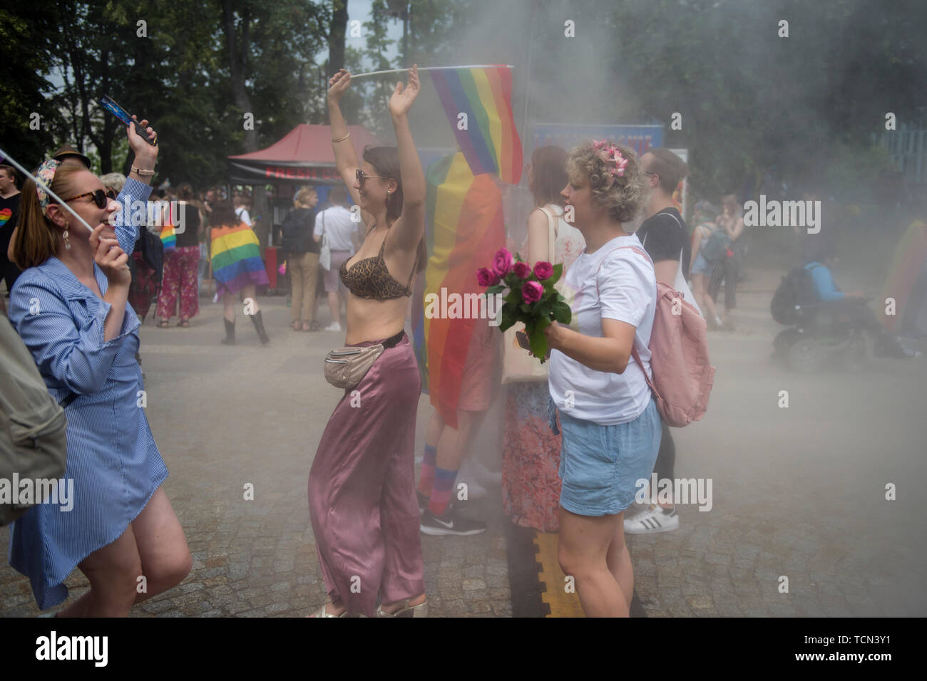 Warsaw, Poland. 08th June, 2019. People covered in smoke during the Warsaw Pride. The Equality March also called the Warsaw Pride parade, brought thousands of people to the streets of Warsaw, at the time when the gay rights movement in Poland is under siege by hate speech and a government campaign depicting it as a threat to families and society. Credit: SOPA Images Limited/Alamy Live News Stock Photo