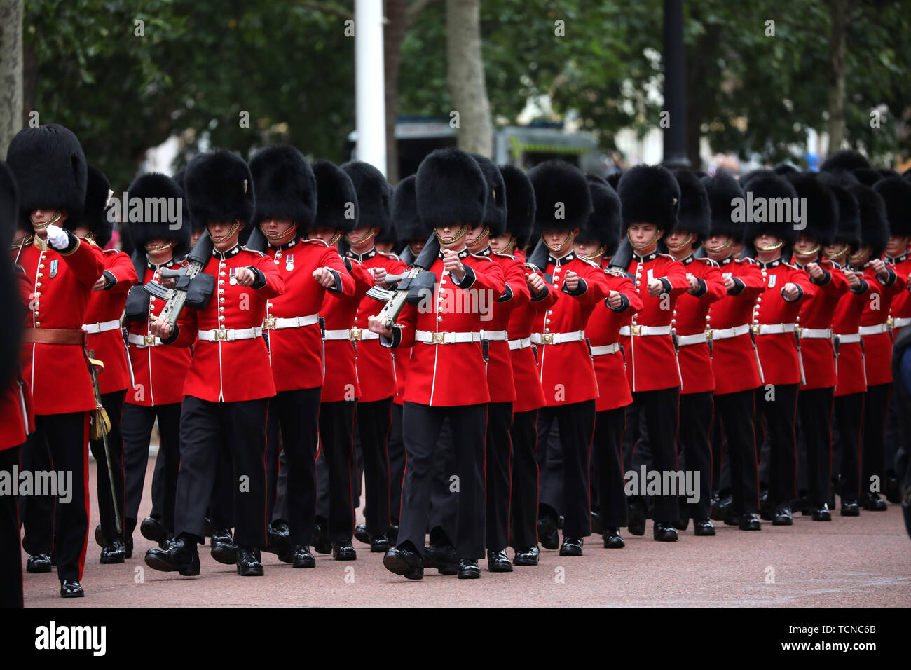 Grenadier Guards make their way up The Mall at the Trooping