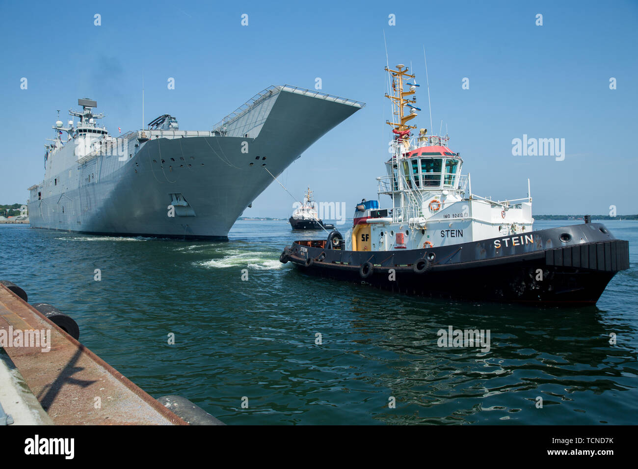 Spanish Navy multi-purpose amphibious assault ship Juan Carlos I (L61), prepares to moor at Naval Base Kiel-Tirpitzhafen, Germany in preparation of exercise Baltic Operations (BALTOPS) 2019, June 5, 2019. BALTOPS is the premier annual maritime-focused exercise in the Baltic region, marking the 47th year of one of the largest exercises in Northern Europe enhancing flexibility and interoperability among allied and partner nations. (U.S. Marine Corps photo by Cpl. Abrey Liggins) Stock Photo