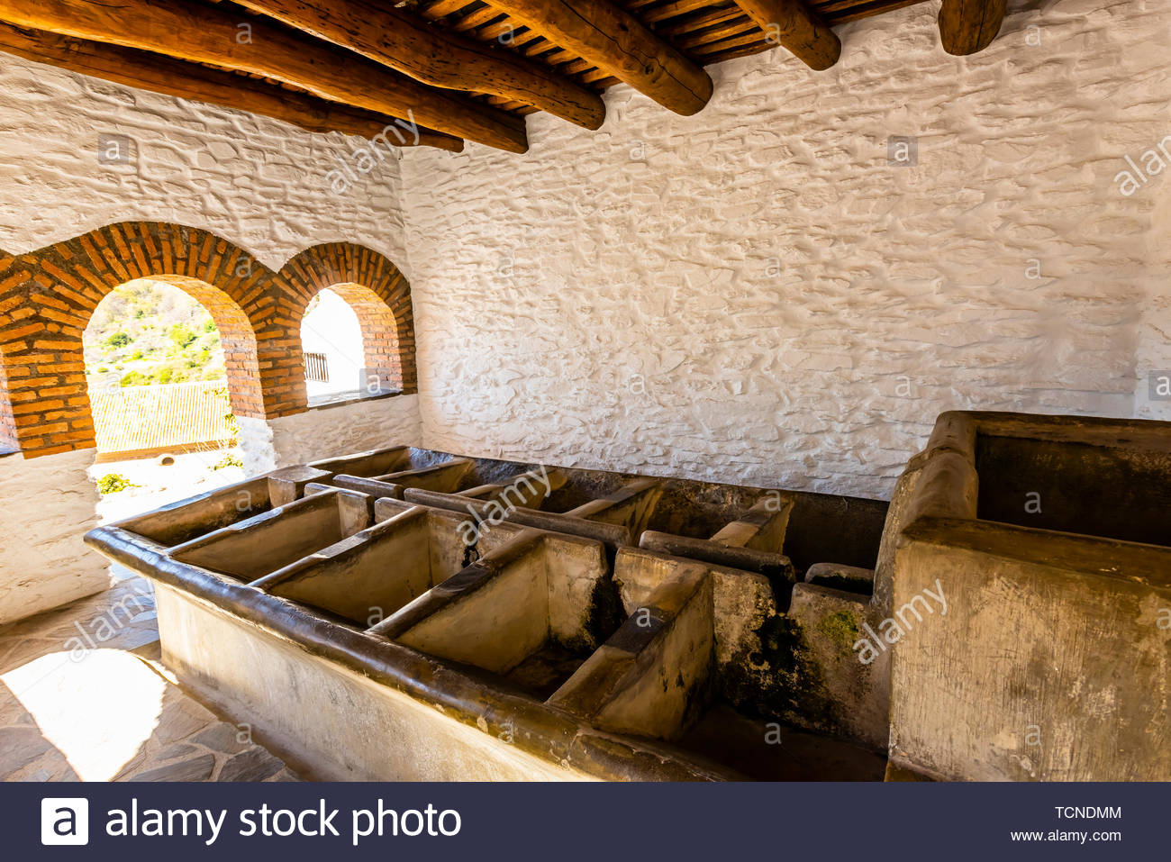 From times past, washing tanks where local women washed clothes, in the mountain village of Pampaneira, Sierra Nevada National Park, Granada Province, - Stock Image