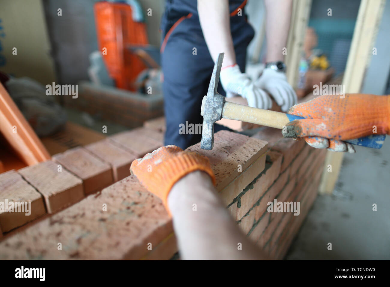 Skilled constructor with hammer - Stock Image