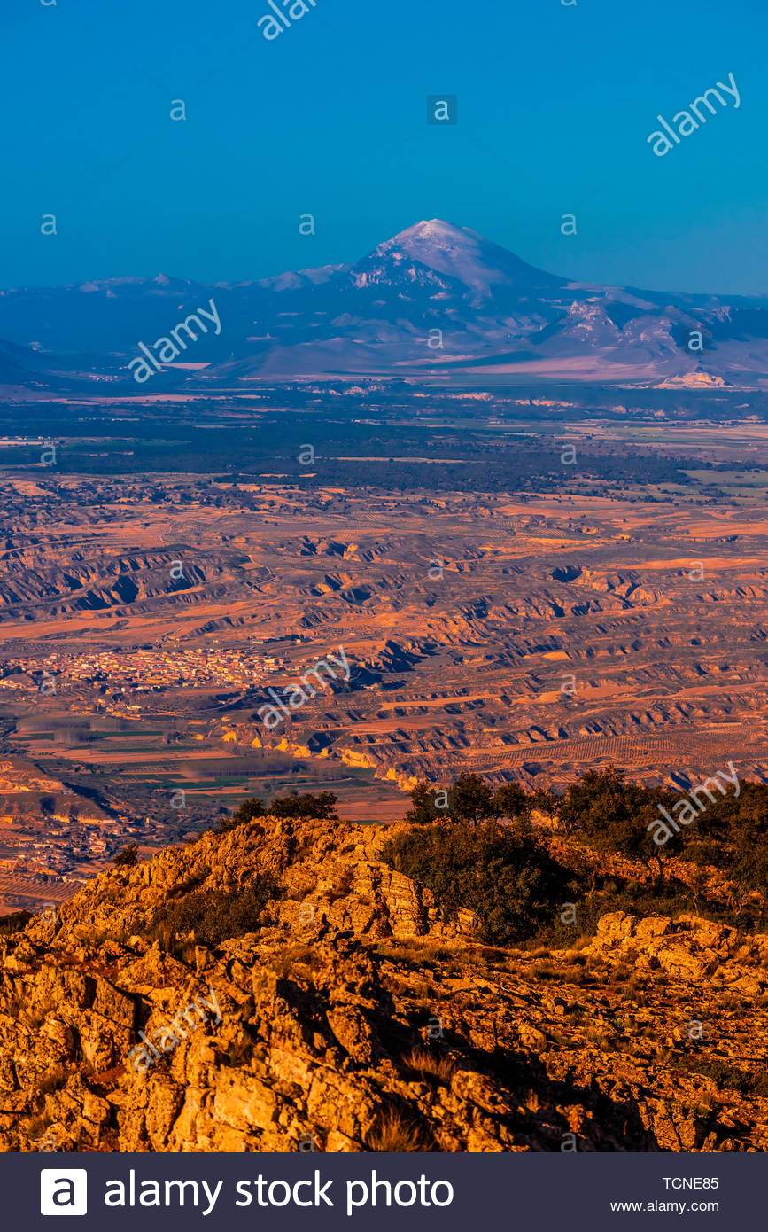 View from Monte Jabalcon of the Guadix-Baza Depression, town of Baza is below, Granada Province, Andalusia, Spain. - Stock Image
