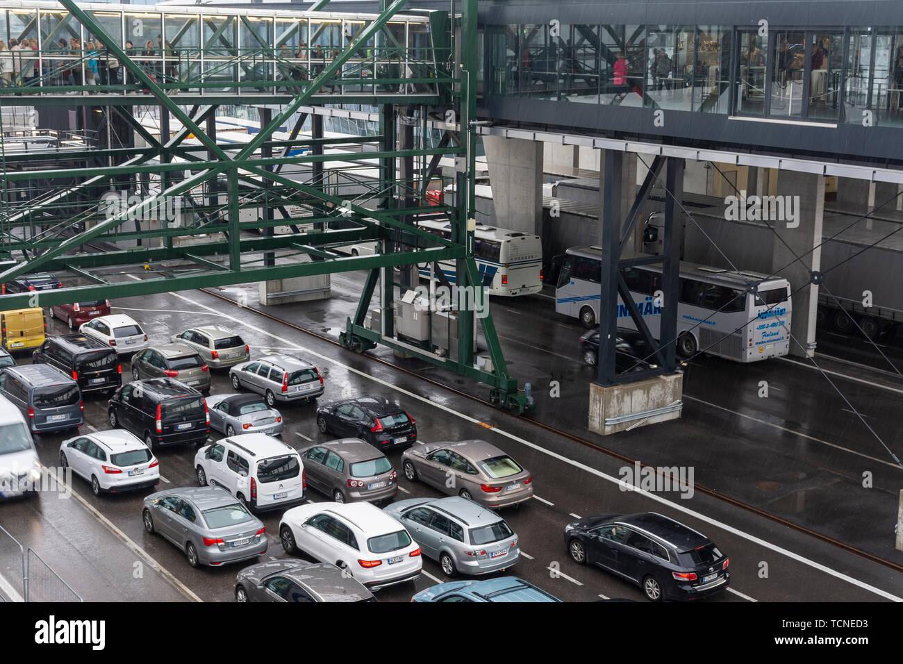 Cars driving into a ship to Helsinki from Tallinn Estonia Stock Photo
