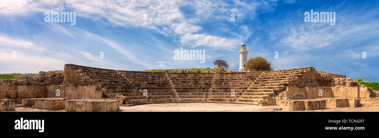 Ancient Odeon amphitheatre in Paphos Archaeological Park (Kato Pafos), harbour of Paphos, Cyprus, panoramic view. Scenic landscape with ruin of mediev Stock Photo