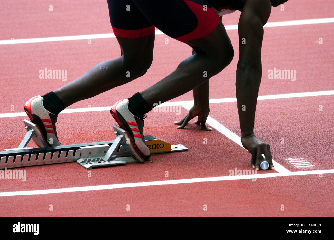 Stade de France Saint Denis near Paris 30.8.2003, IX World Championships in Athletics ---- relay runner at the start - Stock Image