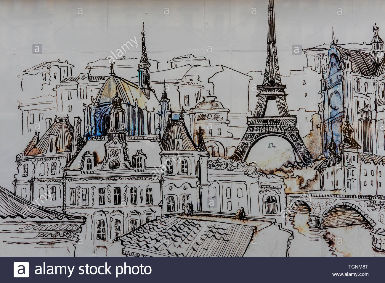 A mural on the side of a building shows the architectural wonders of Paris, France. - Stock Image