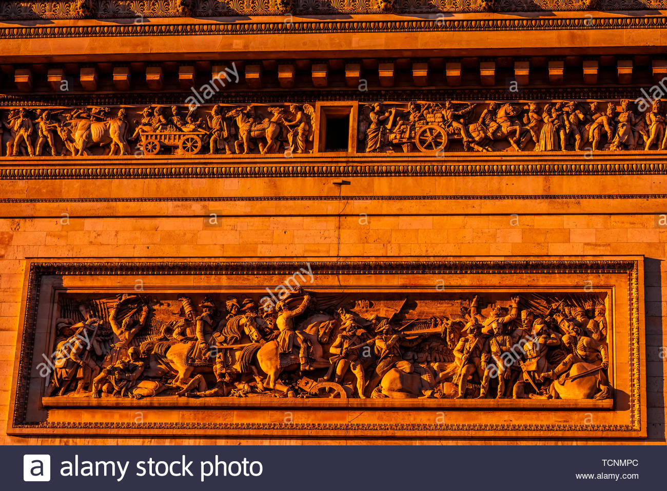 Architectural detail of the Arc de Triomphe (The Arc de Triomphe de l'Étoile) is one of the most famous monuments in Paris, France, standing at the we - Stock Image