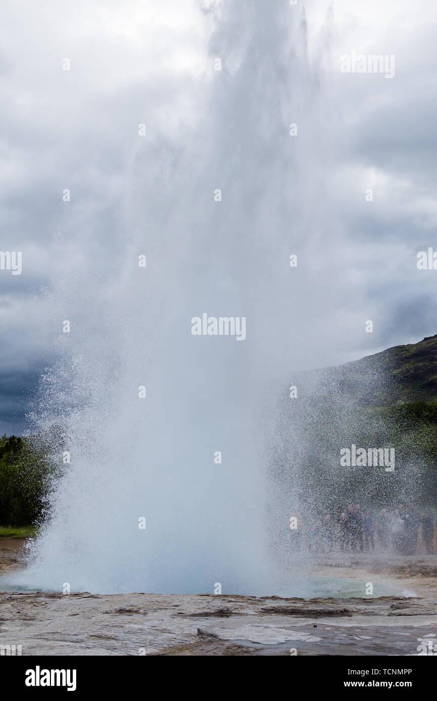 Strokkur geothermal area. Strokkur geyser eruption, Iceland - Stock Image