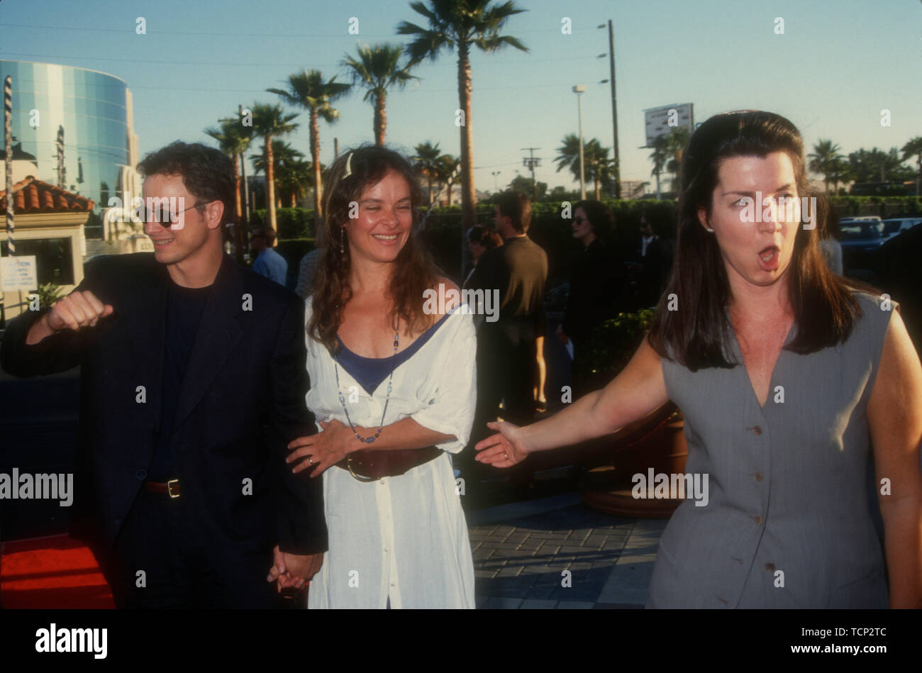 Hollywood, California, USA 23rd June 1994 Actor Gary Sinise, wife actress Moira Harris and publicist Nanci Ryder attend Paramount Pictures 'Forrest Gump' Premiere on June 23, 1994 at Paramount Studios in Hollywood, California, USA. Photo by Barry King/Alamy Stock Photo - Stock Image