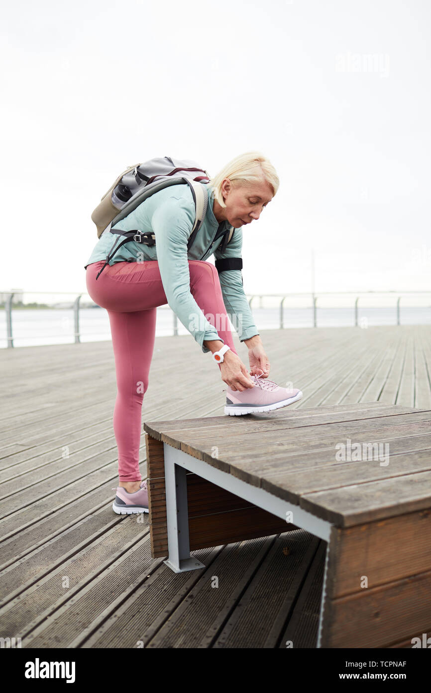 Brilliant Blonde Active Female In Sportswear Tying Shoelace On Sports Beatyapartments Chair Design Images Beatyapartmentscom