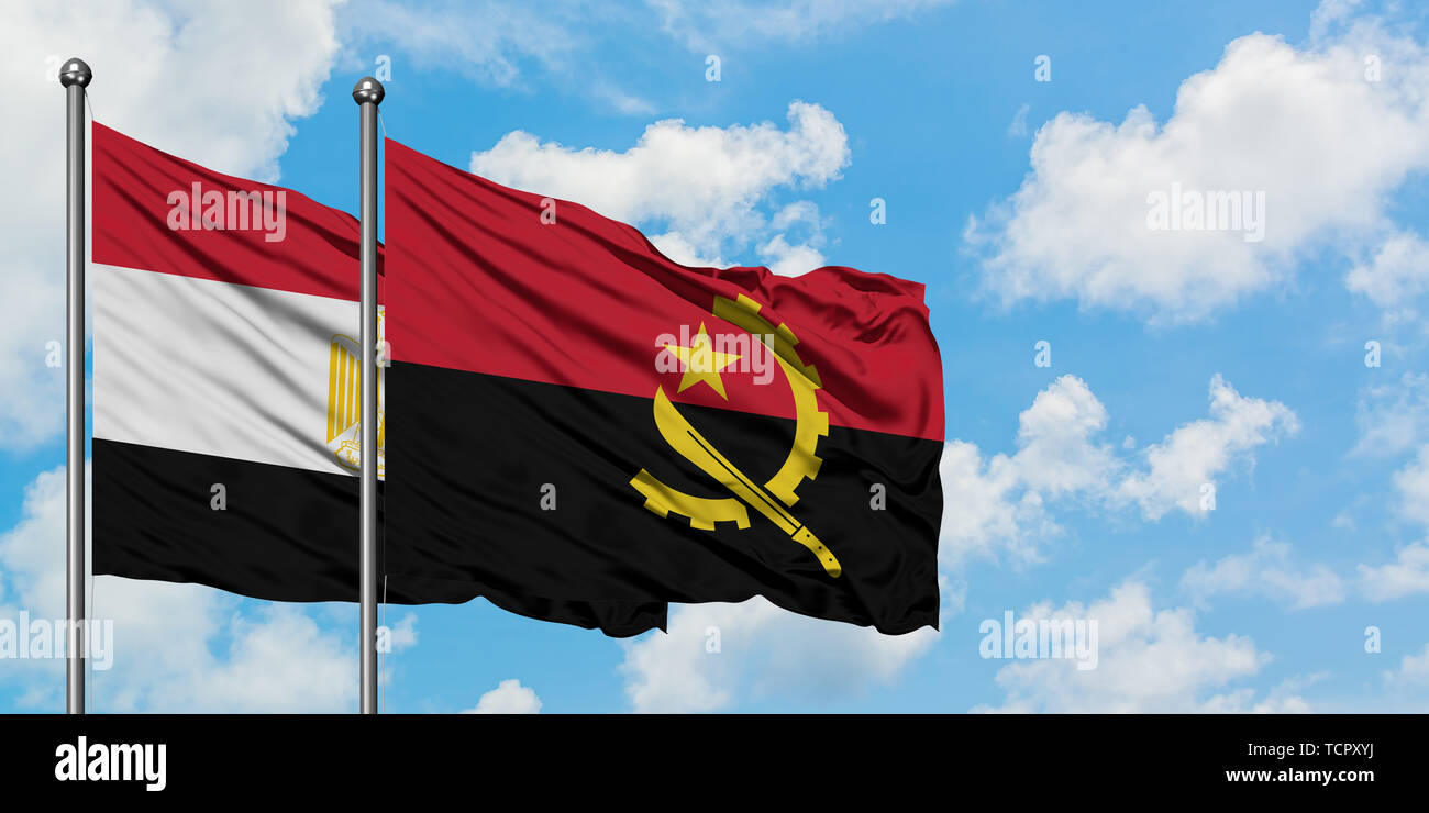 Egypt and Angola flag waving in the wind against white cloudy blue sky together. Diplomacy concept, international relations. - Stock Image