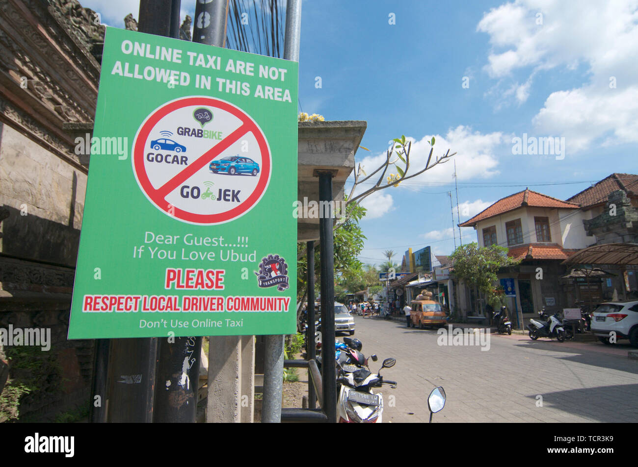 Ubud, Bali, Indonesia - 17th May 2019 : Protest sign place from local people in Ubud against the online taxi services like Uber, Grab etc. located in  Stock Photo