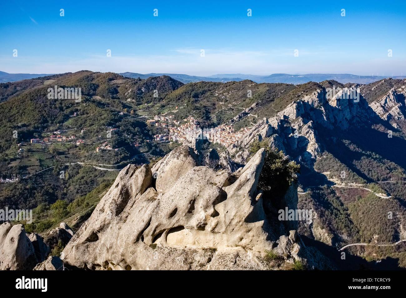Landscape of Dolomites of Basilicata mountains called Dolomiti Lucane.  In the background Castelmezzano village. Basilicata region, Italy Stock Photo