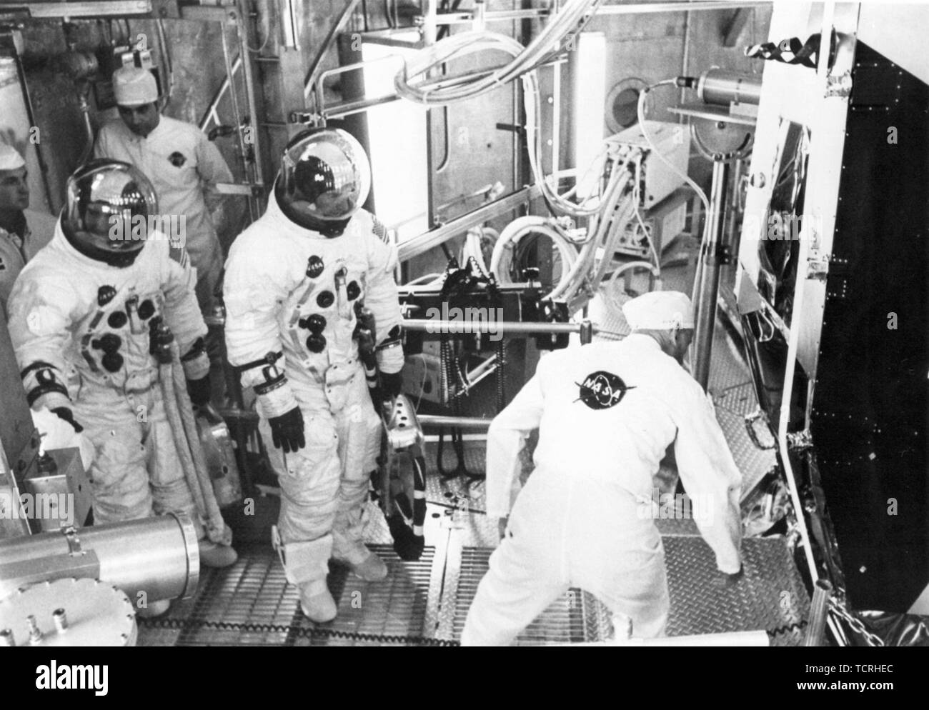Apollo 11 backup crew members Fred Haise (left) and Jim Lovell prepare to enter the Lunar Module for an altitude test. - Stock Image