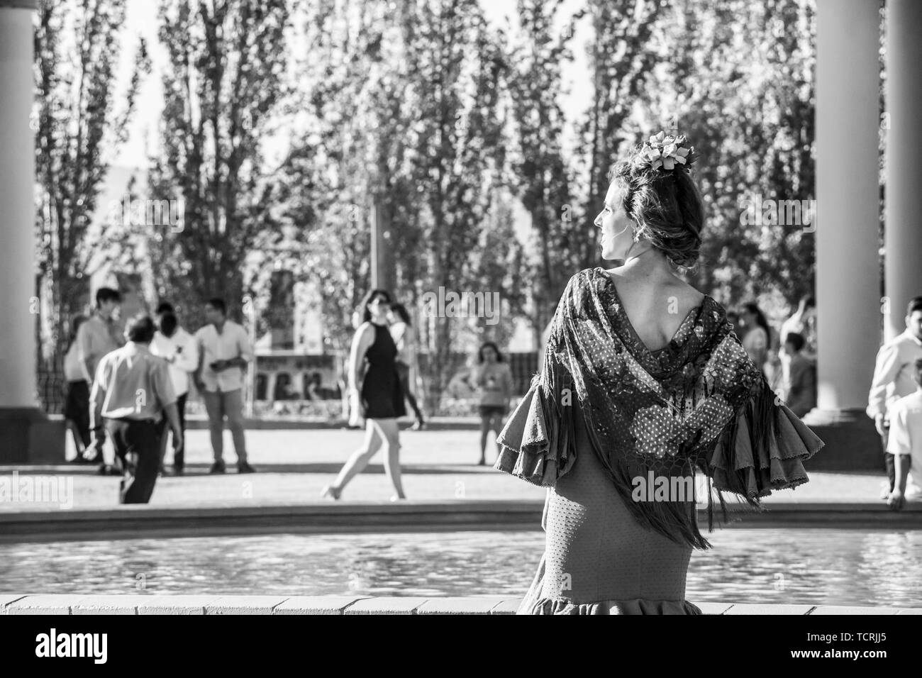 CORDOBA, SPAIN - MAY 30, 2019: Beautiful dressed female participant at Feria de Cordoba, Feria de Nuestra Senora de la Salud or Cordoba Fair, black an Stock Photo