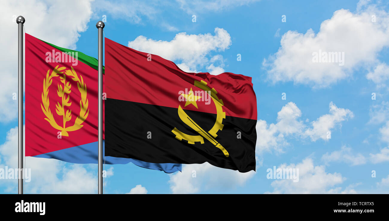 Eritrea and Angola flag waving in the wind against white cloudy blue sky together. Diplomacy concept, international relations. Stock Photo