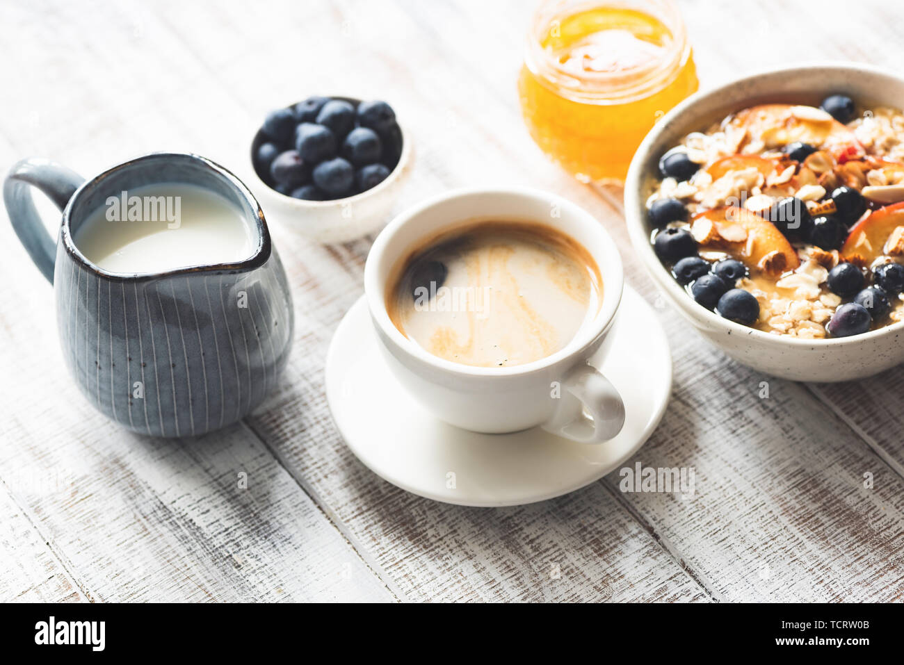 Cup Of Coffee Espresso And Breakfast Food Oatmeal Porridge With Fruits Berries Honey On Rustic White Wooden Table Background Stock Photo Alamy