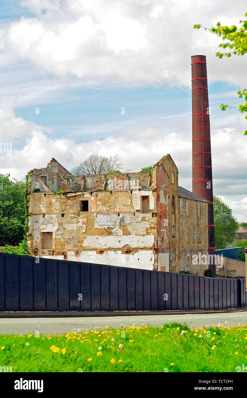 19th century weaving mill and chimney under demolition - Stock Image