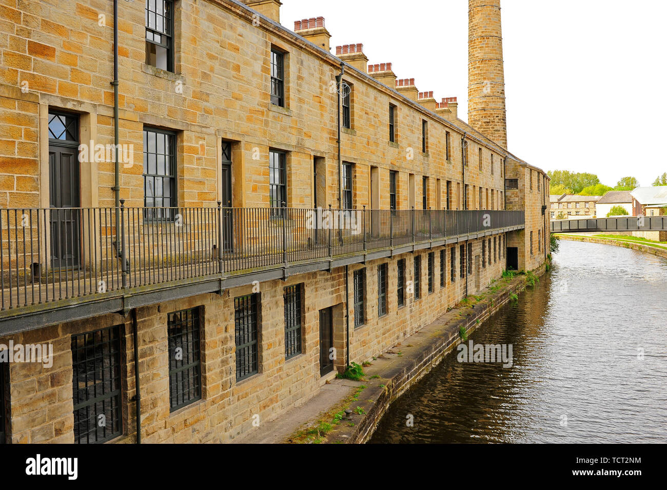 Slater Terrace formerly a weaving shed now renovated office space on the banks of the Leeds Liverpool canal at Burnley,UK - Stock Image