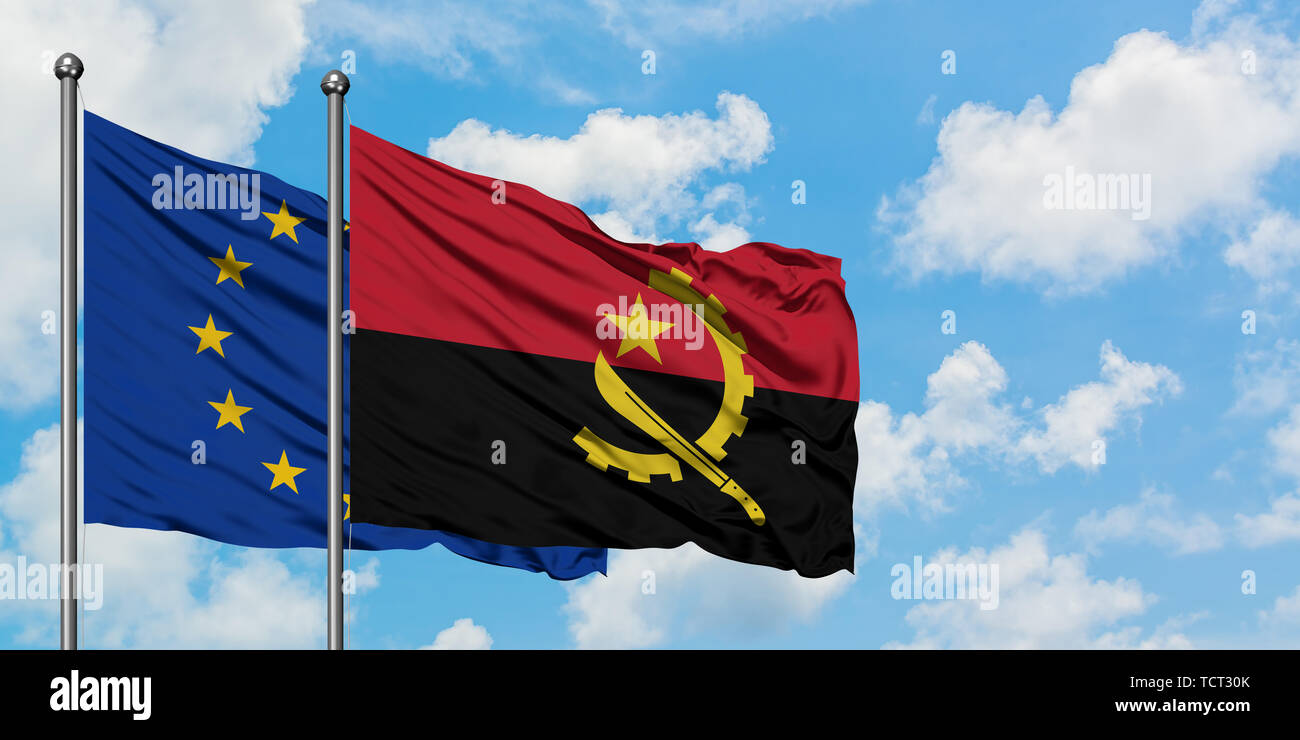 European Union and Angola flag waving in the wind against white cloudy blue sky together. Diplomacy concept, international relations. - Stock Image