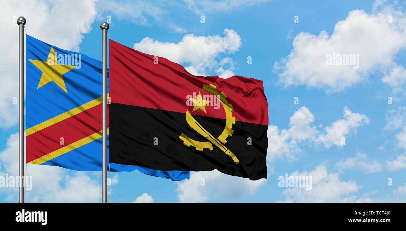 Congo and Angola flag waving in the wind against white cloudy blue sky together. Diplomacy concept, international relations. - Stock Image