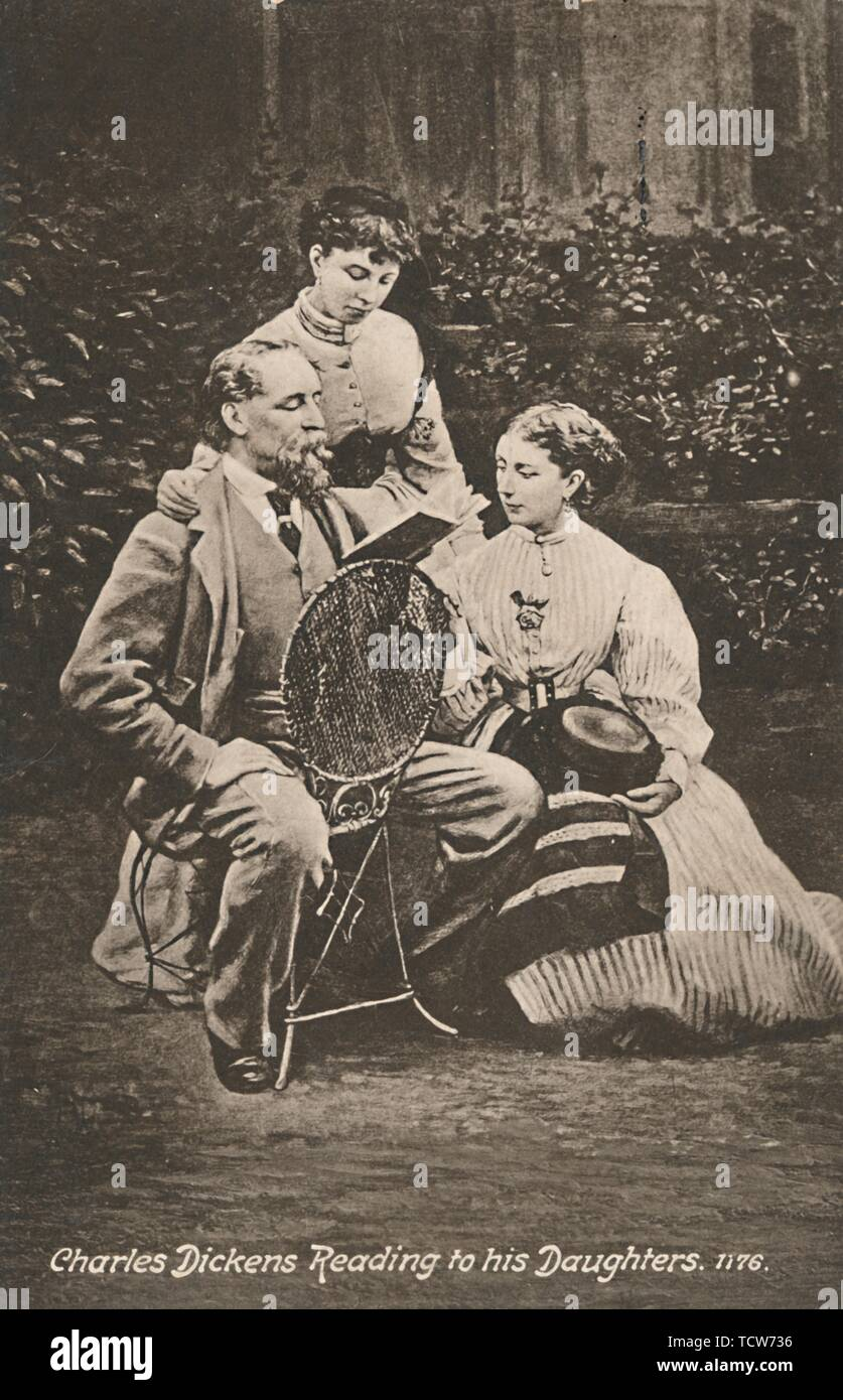 'Charles Dickens Reading to his Daughters', 1865. British novelist Charles Dickens (1812-1870) with his daughters Mary and Kate in the garden of his home, Gad's Hill, in Kent. Postcard. - Stock Image