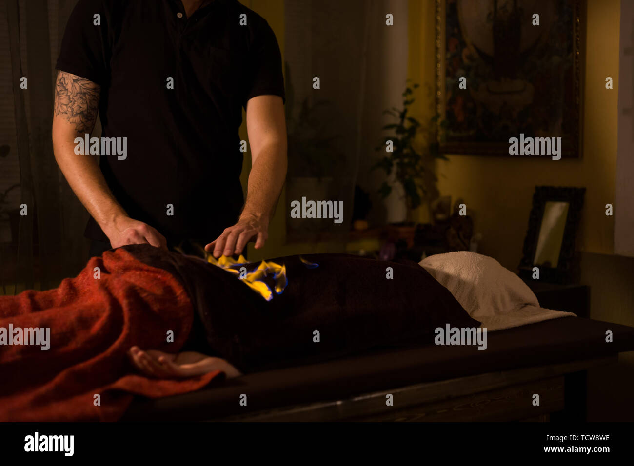 Chinese fire massage and therapy - Stock Image