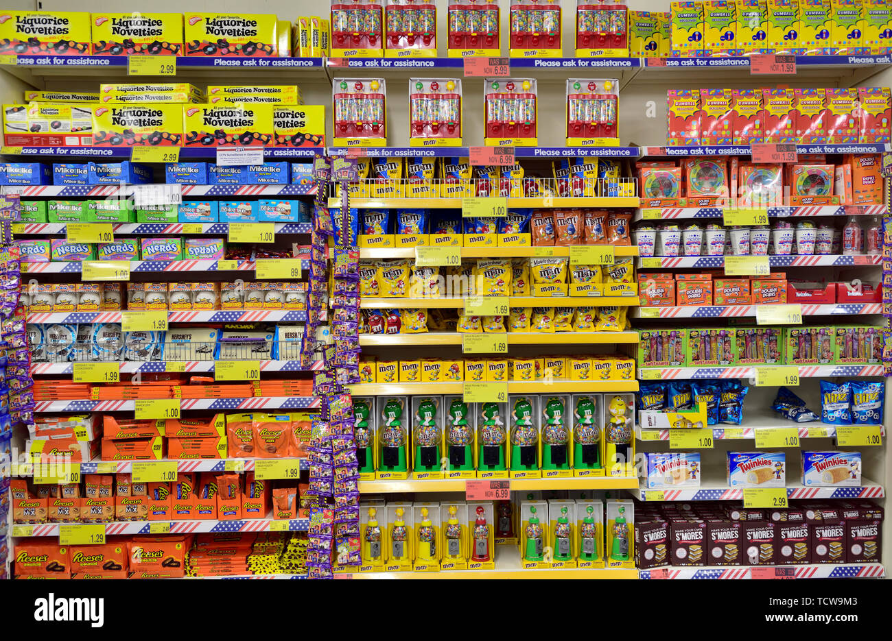 Multiple shelves full of a variety of sweets on display in store. B&M discount store, Bristol Stock Photo