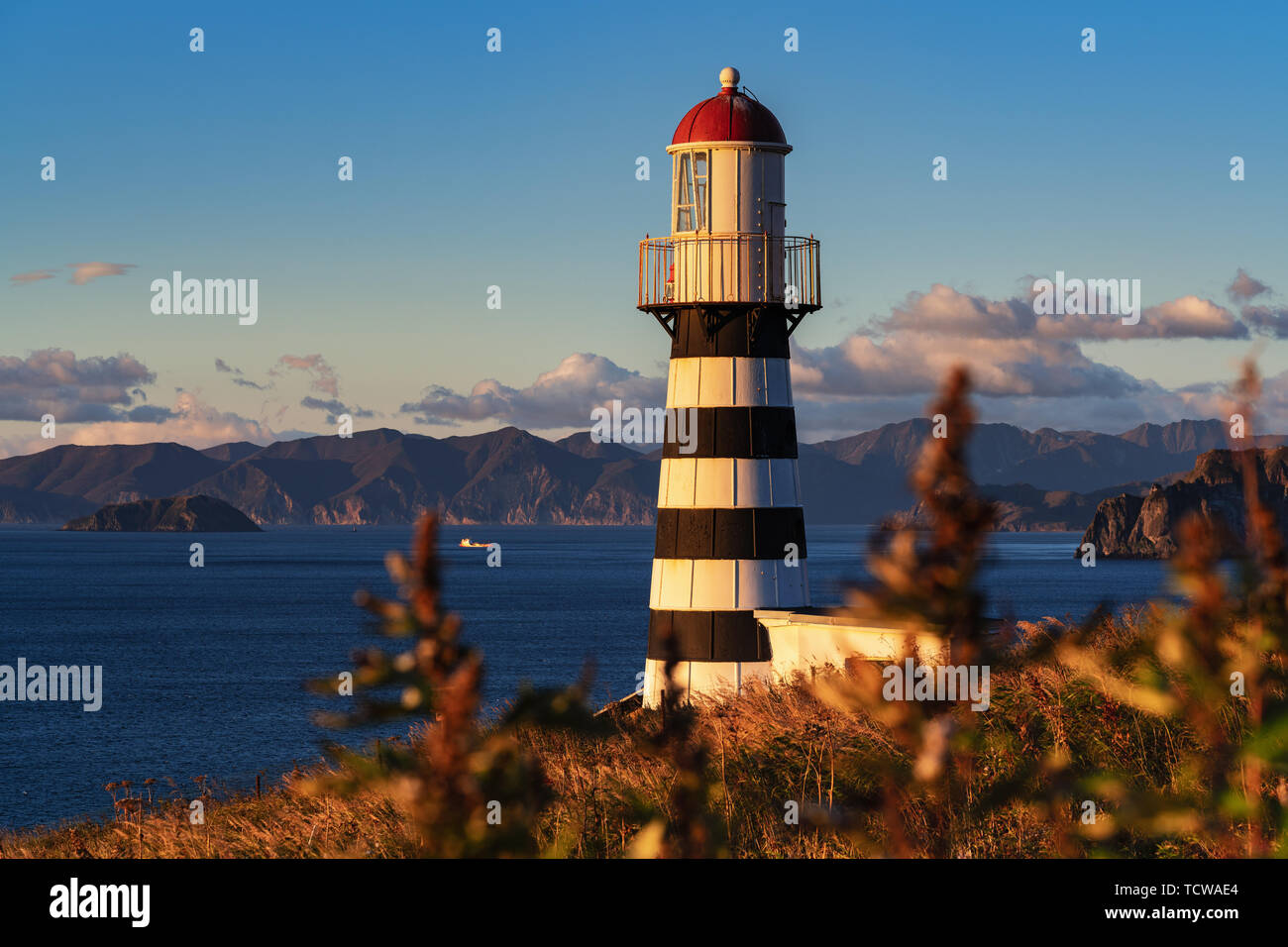 Petropavlovsky Lighthouse (founded in 1850) - oldest lighthouse in Russian Far East, located on Kamchatka Peninsula on shore of Pacific Ocean Stock Photo