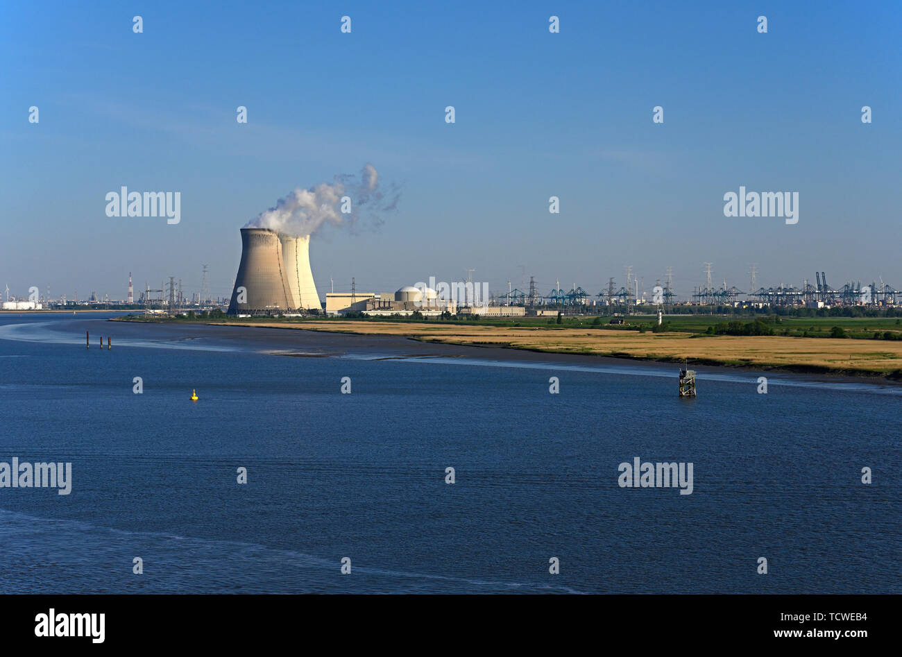 antwerp, belgium - 2019.05.15:  panoramic view over river schelde onto doel nuclear power station and port of antwerp container terminals - Stock Image