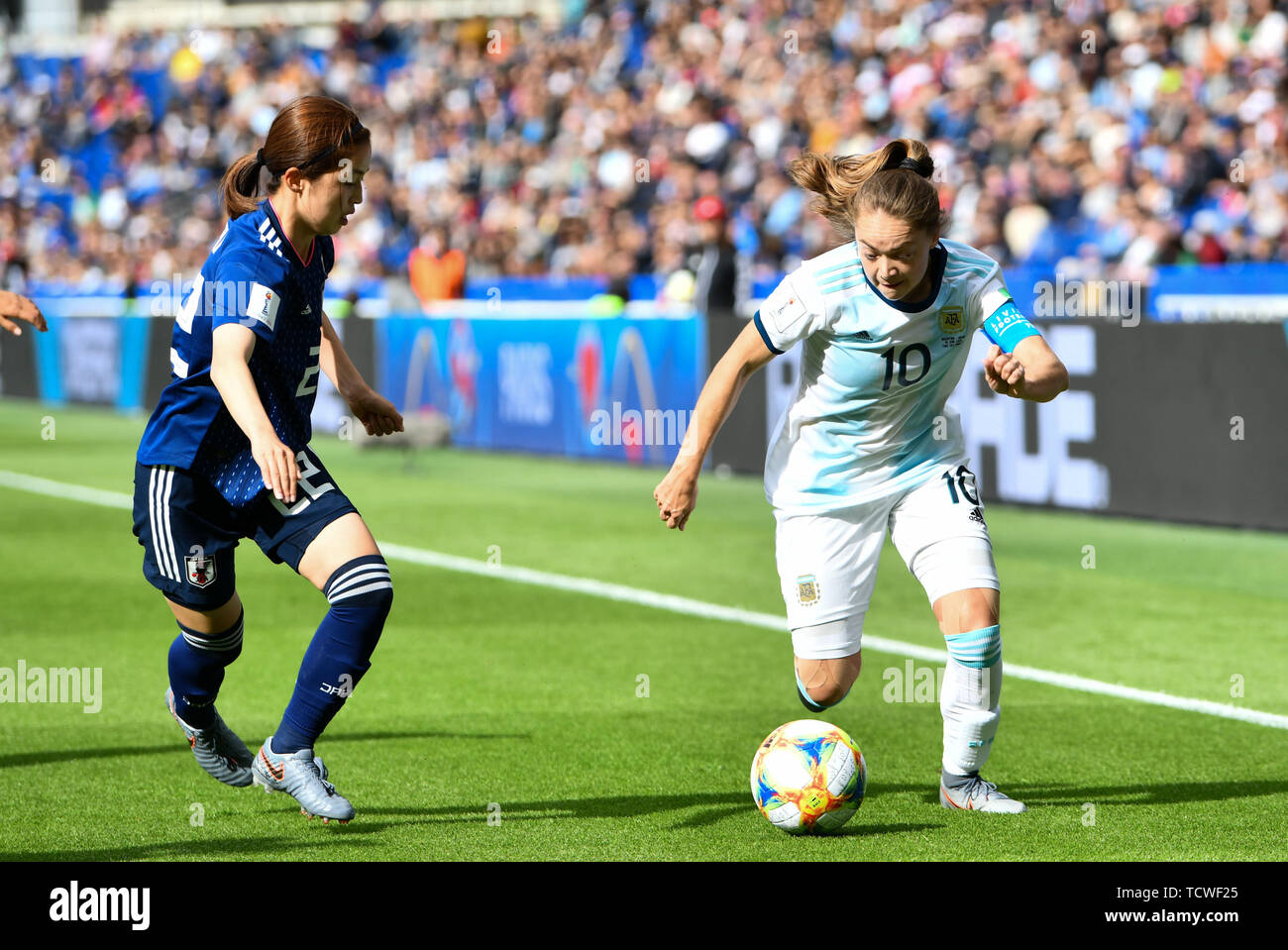 10 june 2019 Paris, France Soccer Women's World Cup France 2019: Argentina v Japan   Risa Shimizu (Japan) (22) looks behind Estefania Romina Banini (A - Stock Image
