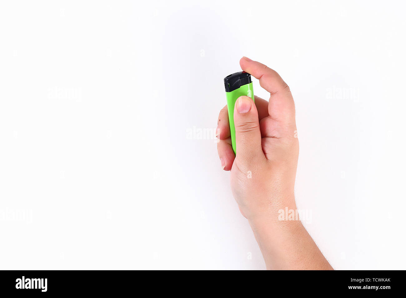 The girl ignites a lighter on a white background. Top view. Stock Photo