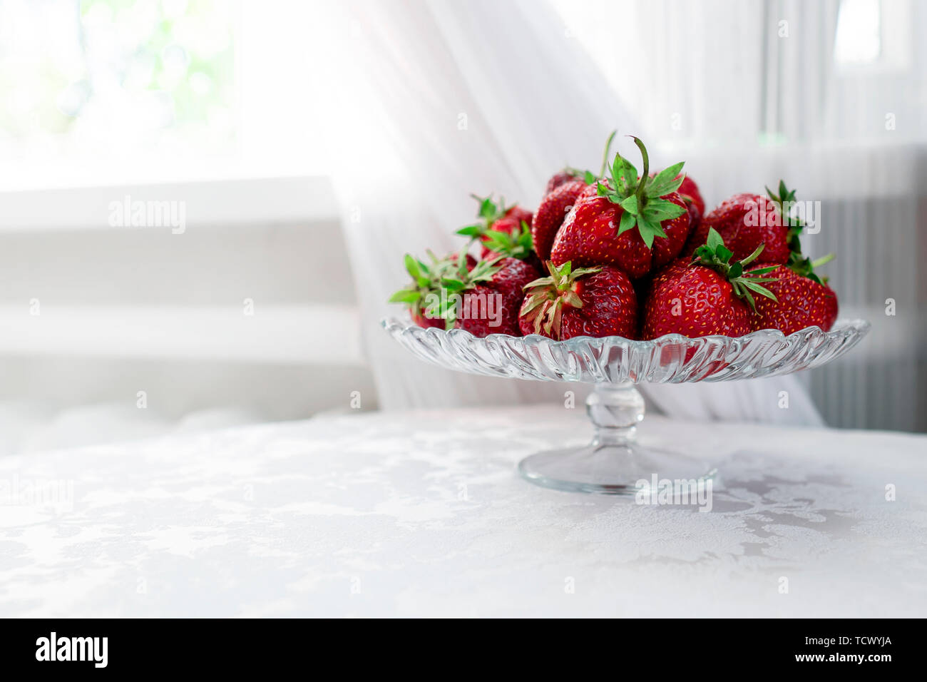 still life of fresh strawberries on the table - Stock Image