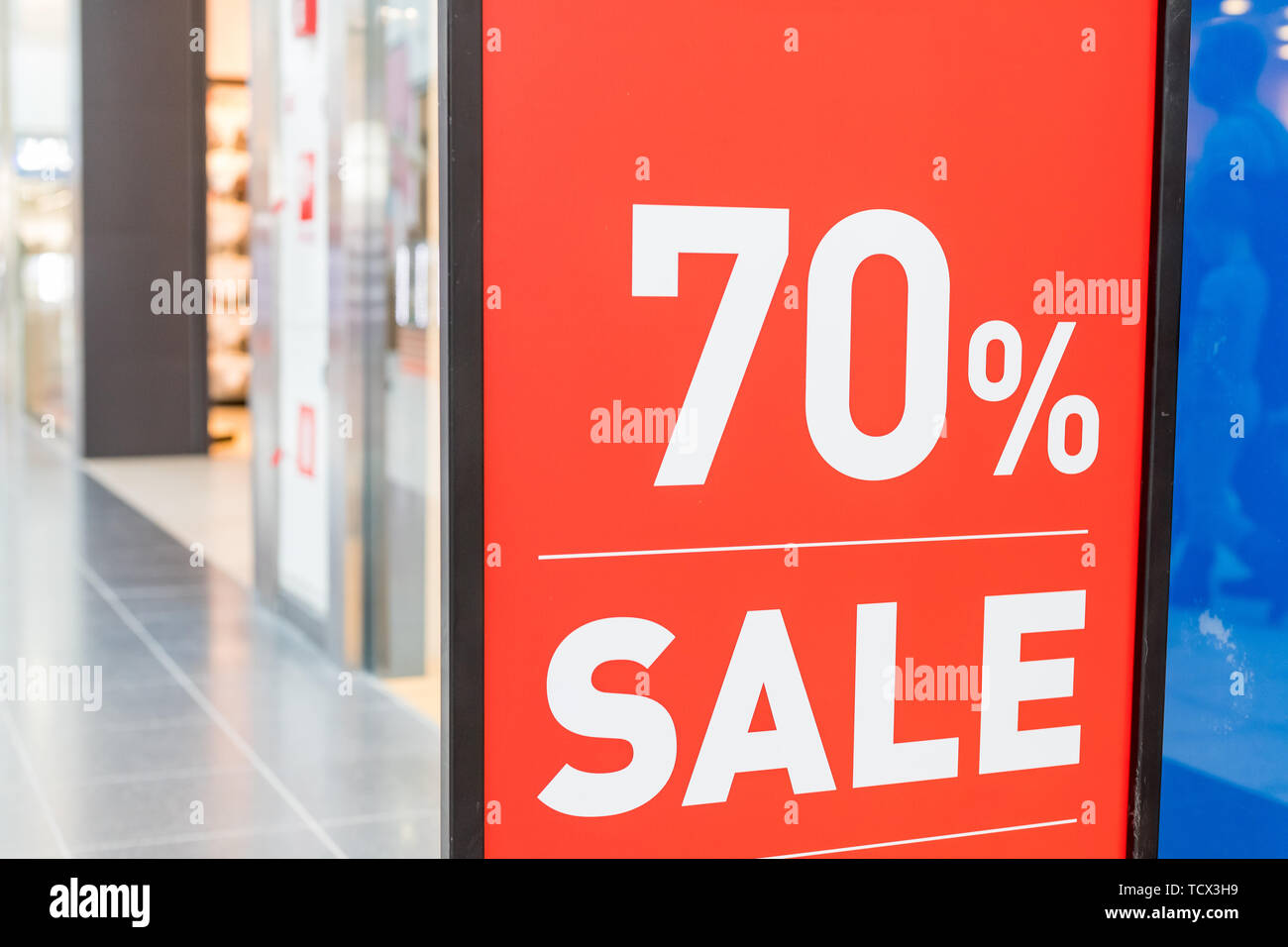 Sale label, in a clothes store showcase. Summer sales season.Signboard Summer sale in shop window.Total sale .shopping time cocept.70 off discount - Stock Image
