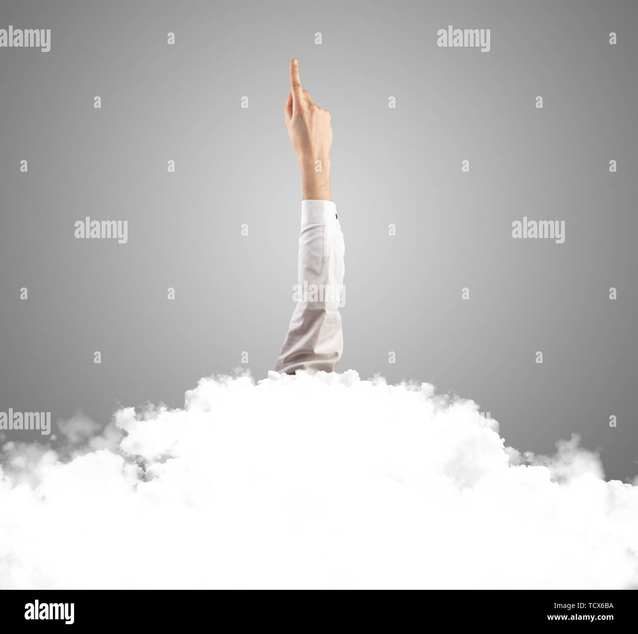 Hand breaking out from the cloud  - Stock Image