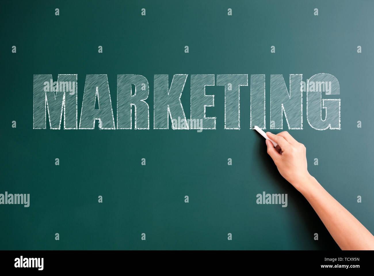 marketing written on blackboard - Stock Image