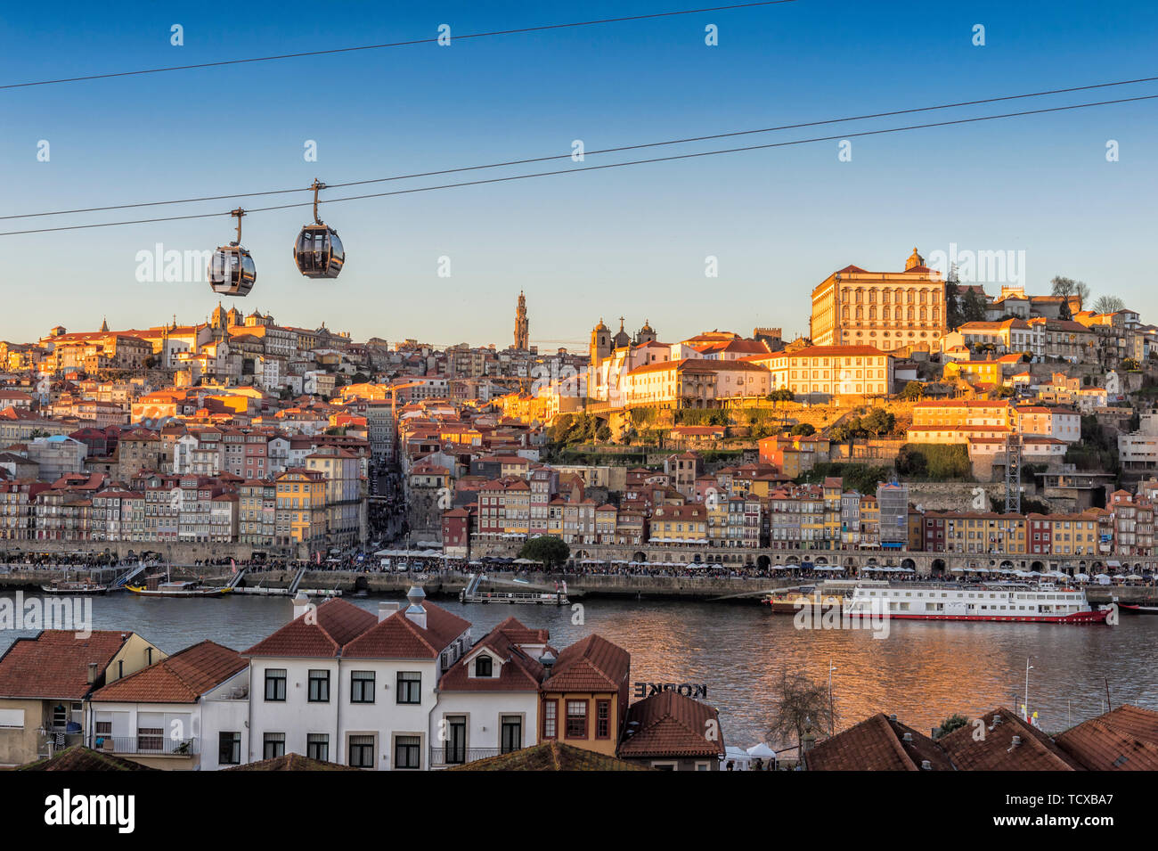 Sunset over Ribeira district and former Episcopal Palace, UNESCO World Heritage Site, Porto, Portugal, Europe Stock Photo
