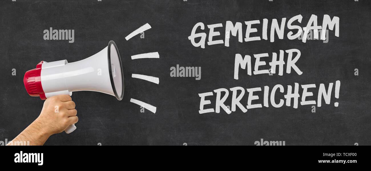 German Translation of Together we can achieve more - Gemeinsam mehr erreichen - Stock Image