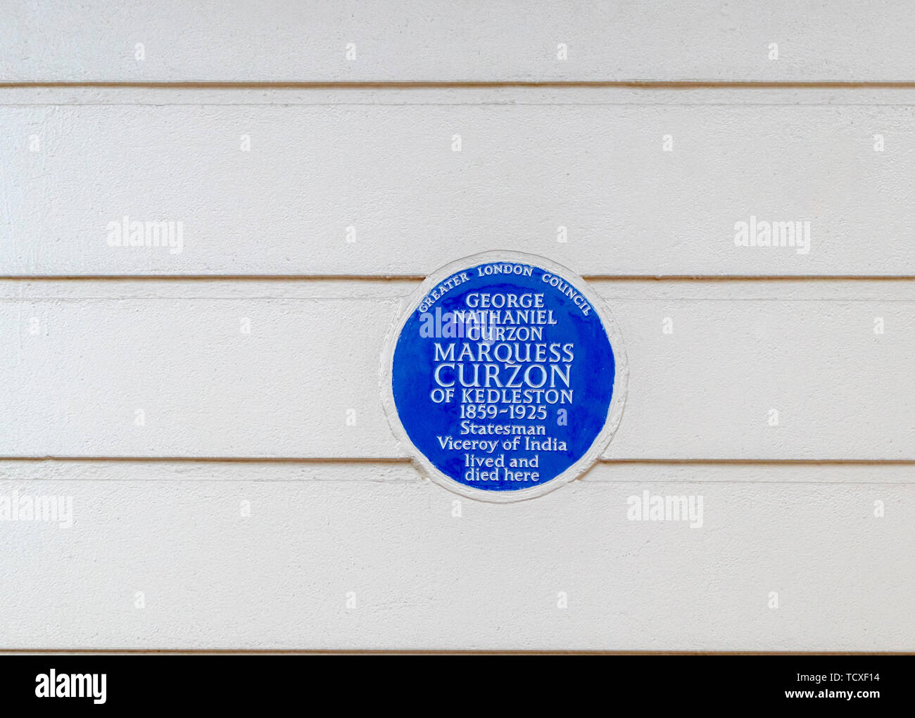 Blue plaque, Marquess Curzon of Kedleston 1859-1925, Viceroy of India, who lived and died in Carlton House Terrace, City of Westminster, London, SW1 Stock Photo