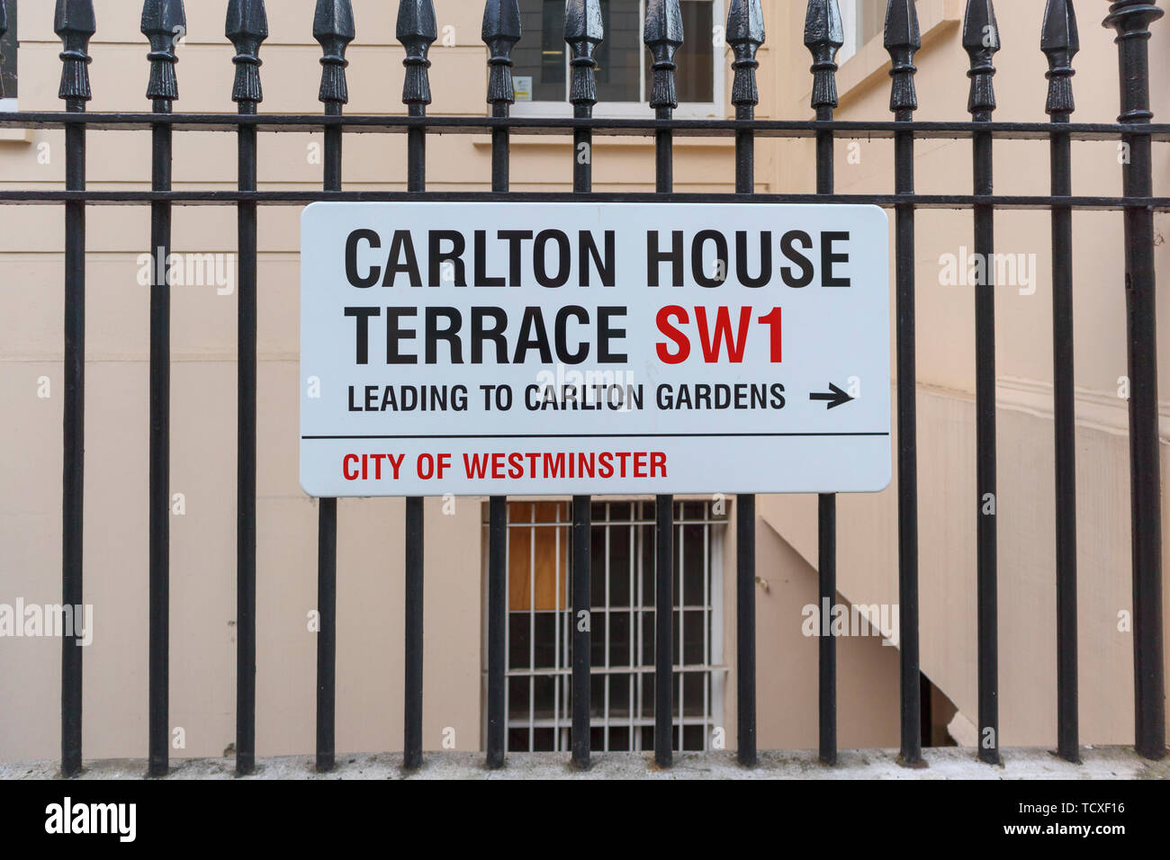Roadside street name sign on iron railings for Carlton House Terrace, leading to Carlton Gardens, City of Westminster, London, SW1, UK - Stock Image