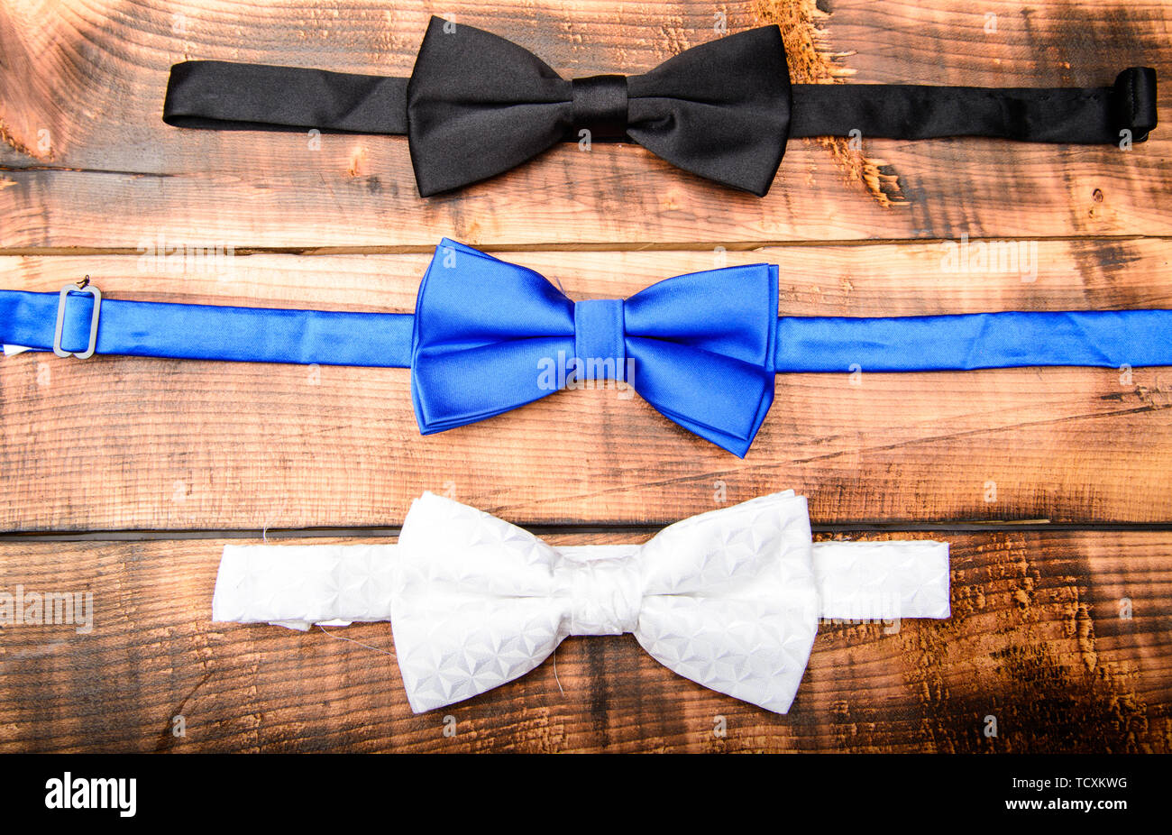 Fashion accessory. Esthete detail. Fix bow tie. Groom wedding. Textile fabric bow close up. Modern formal style. Menswear clothes. Perfect outfit. Tying bow tie. Wedding accessories. - Stock Image