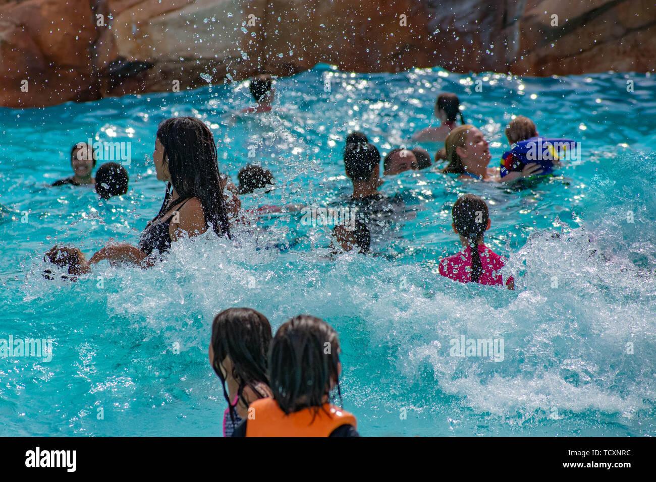 Orlando, Florida. April 07, 2019. Parents and kids having fun pool on bluelight water at Aquatica (2) Stock Photo