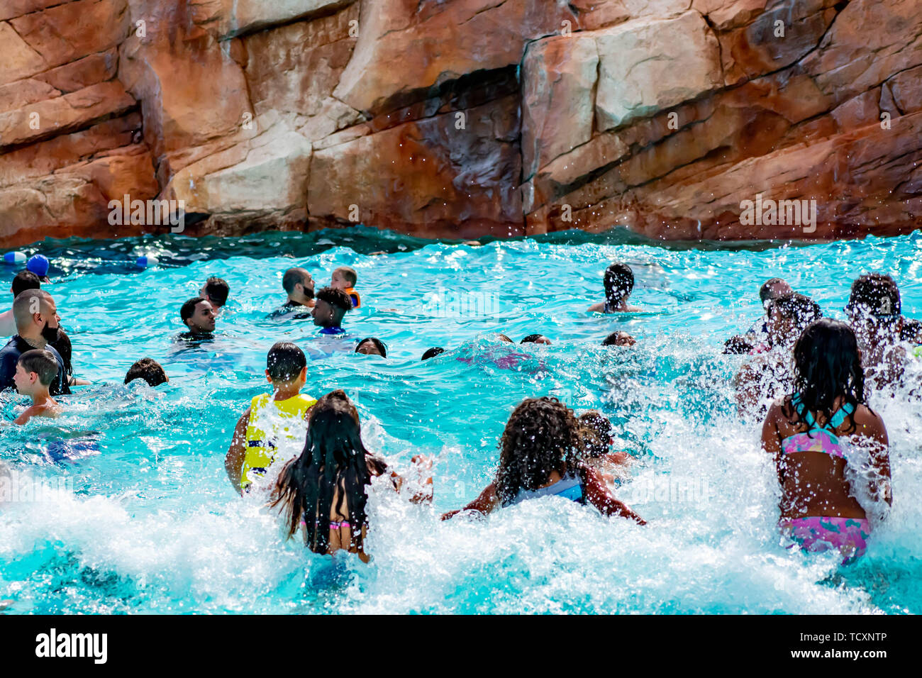 Orlando, Florida. April 07, 2019. Parents and kids having fun pool on bluelight water at Aquatica (5) Stock Photo