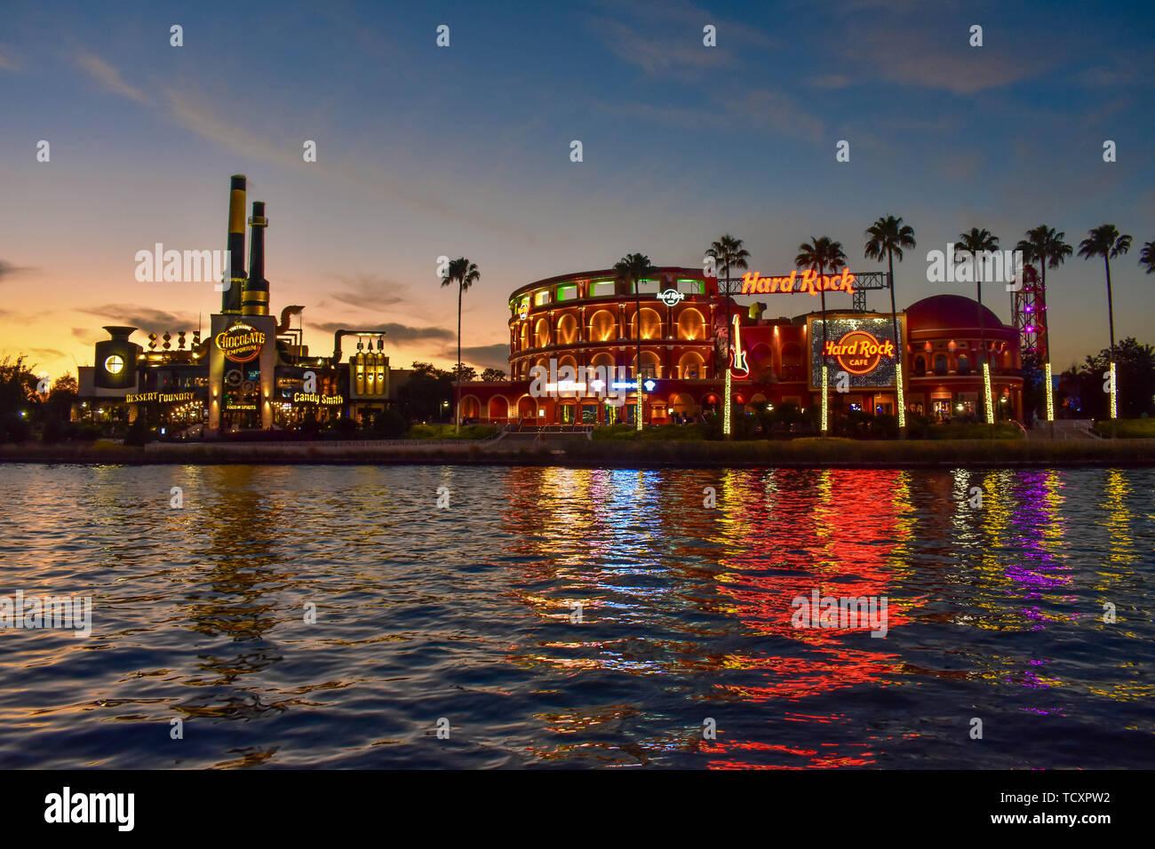 Orlando, Florida. February 05, 2019.  Chocolate Emporium Restaurant and Hard Rock Cafe on colorful sunset background at Universal Studios area. - Stock Image