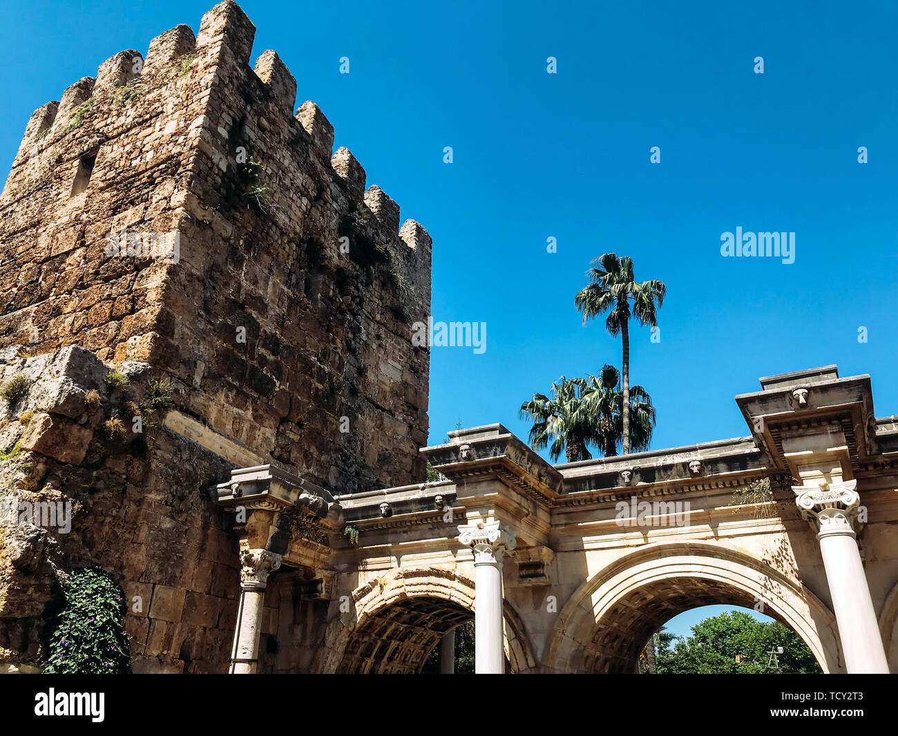 Hadrian's Gate in Antalya The upper part of the Hadrian Gate and the old tower Bottom view in summer sunny day - Stock Image