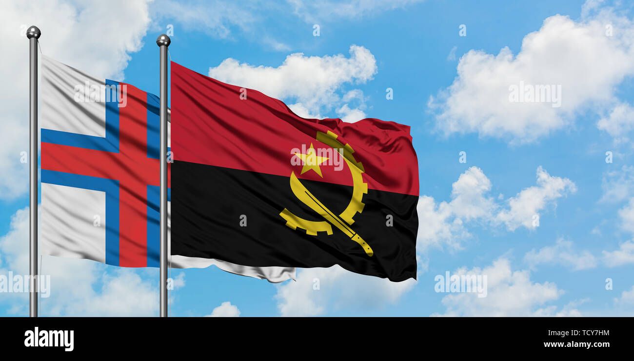 Faroe Islands and Angola flag waving in the wind against white cloudy blue sky together. Diplomacy concept, international relations. - Stock Image