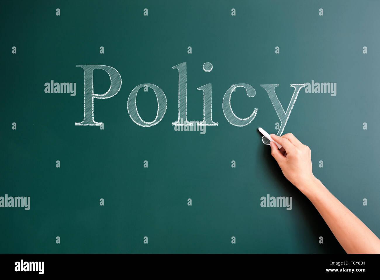 policy written on blackboard - Stock Image