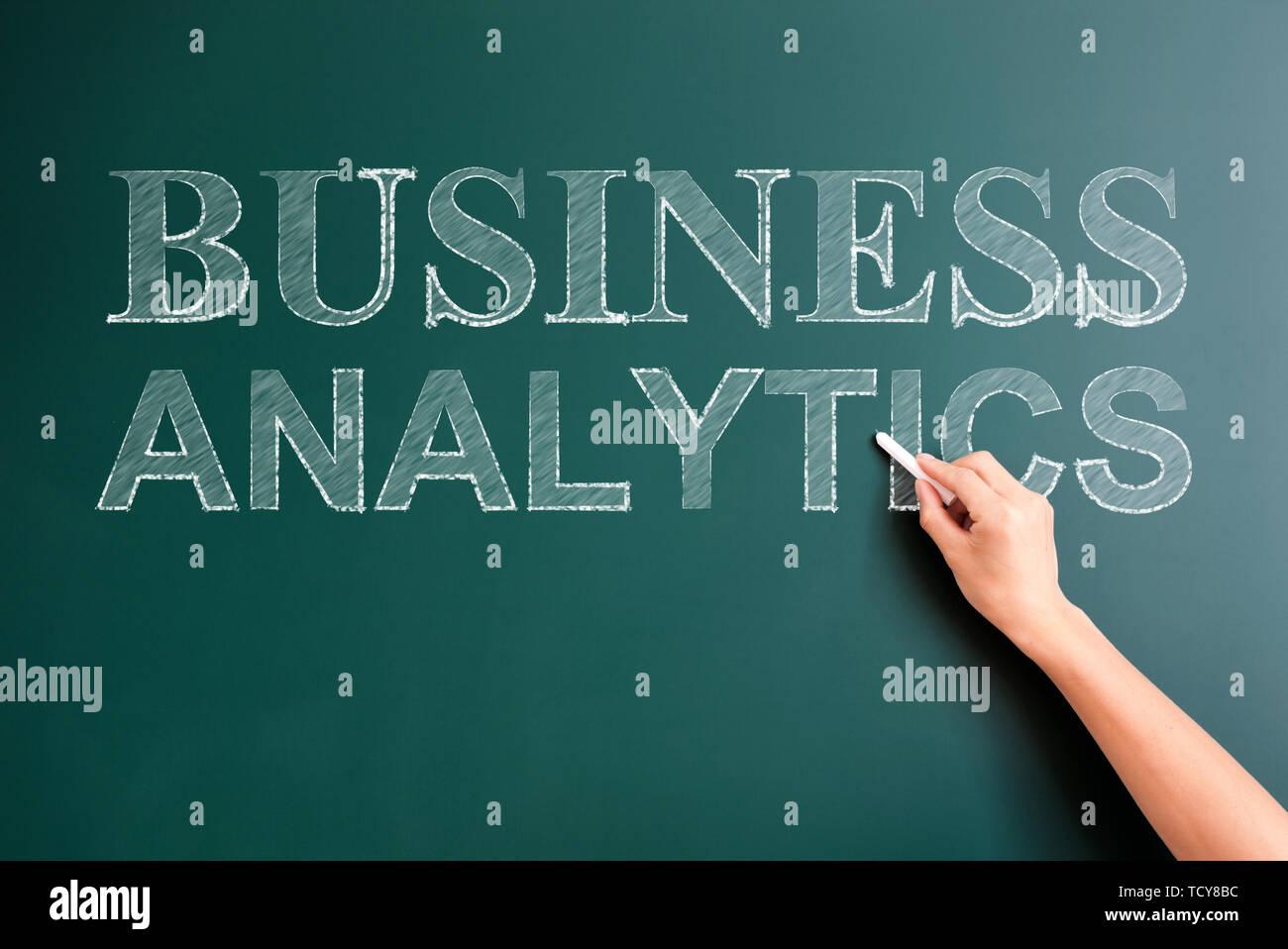 business analytics written on blackboard - Stock Image