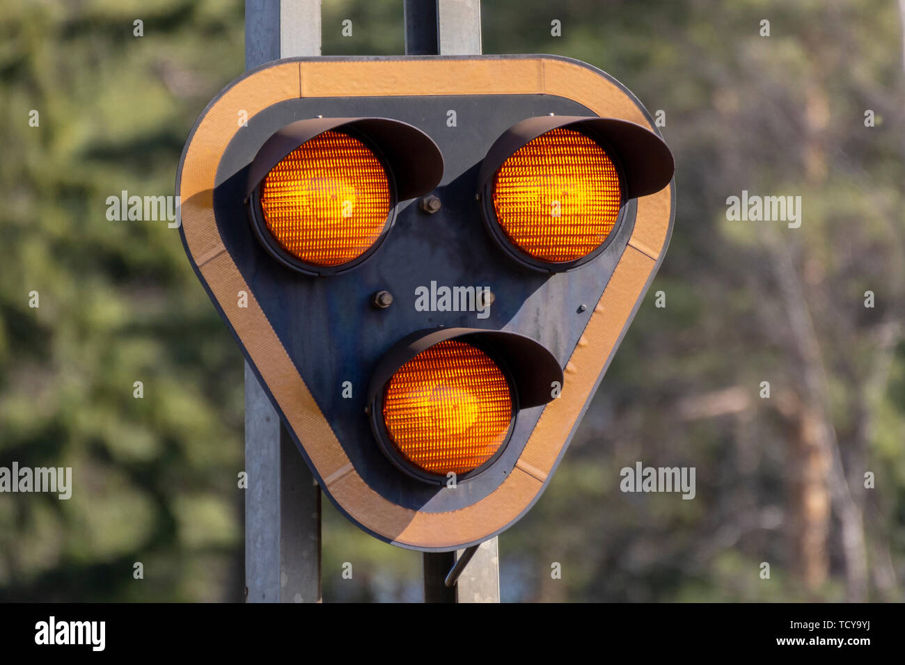 Traffic light for train with three lights, all lighted upp, picture from Northern sweden. - Stock Image